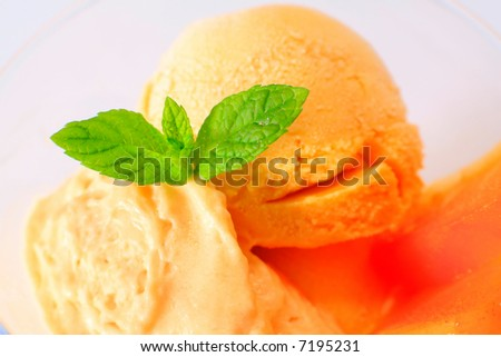 icecream with pieces of kaki/persimmon - stock photo