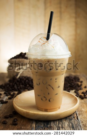 iced cappuccino with straw in plastic cup - stock photo