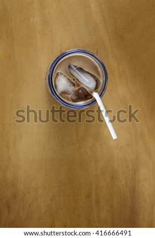 Iced chocolate on wood background, top view
