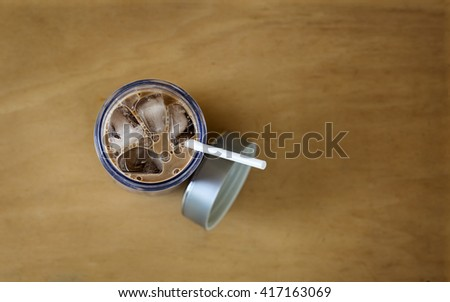 Iced chocolate on wood background, top view - stock photo