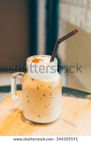 Iced coffee at cafe on wooden table