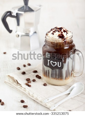 Iced coffee, frapuccino with whipped cream and chocolate syrup   - stock photo