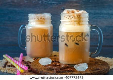 Iced coffee in a tall glass with chocolate