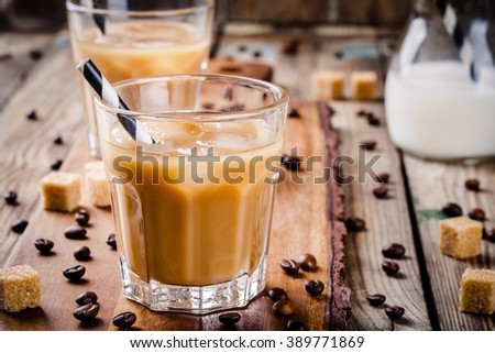 Iced coffee in glass closeup on wooden table - stock photo