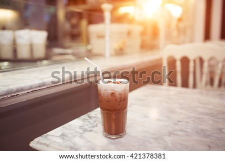Iced coffee in glass on table. Selective focus. - stock photo