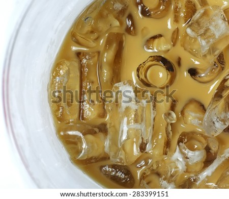 Iced coffee in glass (top view) - stock photo