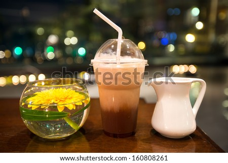 Iced coffee in night background - stock photo