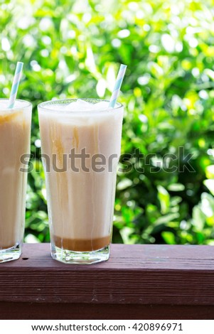 Iced coffee in tall glasses outside on the front porch