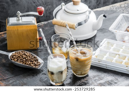 Iced coffee latte homemade making from ice cubes coffee frozen served with milk. - stock photo