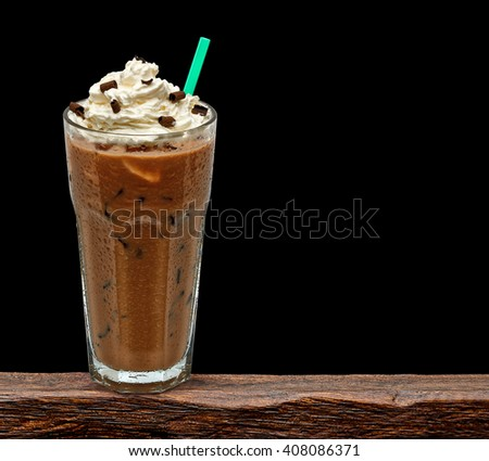 Iced coffee mocha in glass on wooden table - stock photo