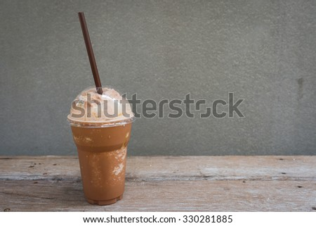Iced Coffee Mocha on the wood table - stock photo