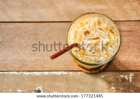 Iced coffee on wood background - stock photo