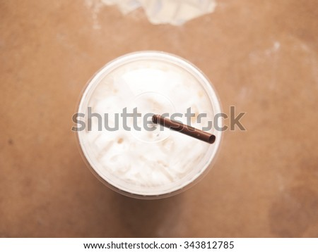 Iced coffee with milk or cream on top view background - stock photo