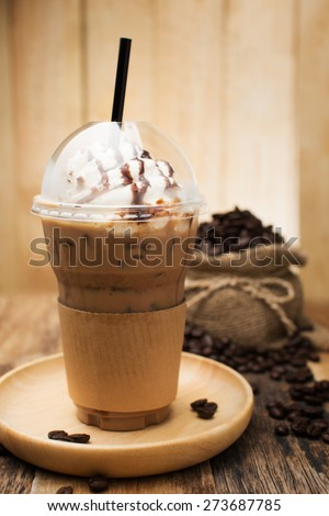 Iced coffee with straw in plastic cup - stock photo