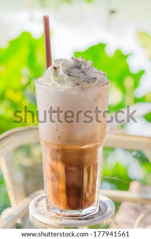 Iced coffee with whipped cream and sprinkle cocoa - stock photo