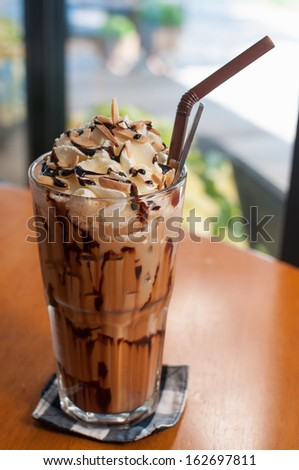 Iced coffee with whipped cream and sprinkle with almonds - stock photo