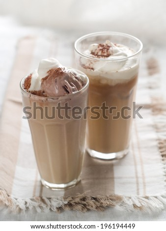 Iced coffee with whipped cream, selective focus