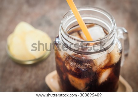 Iced cola with potato chips, stock photo