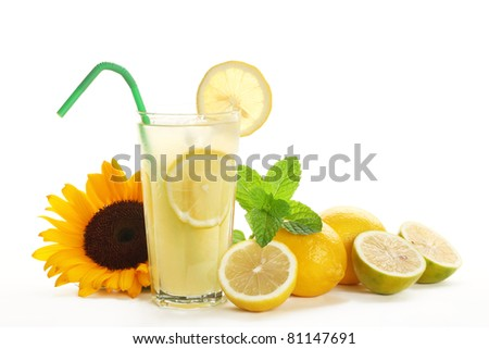 Iced drink with mint, citrus fruit and sunflower. - stock photo