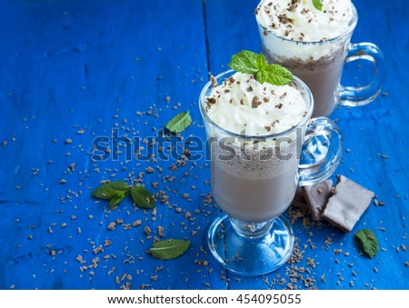 Iced frappe dessert with cream and chocolate decorated with mint leaves - stock photo