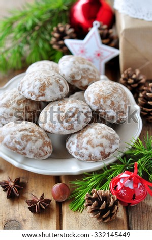 Iced gingerbread cookie and Christmas decorations