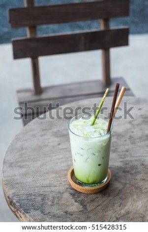 iced green tea latte on the table.