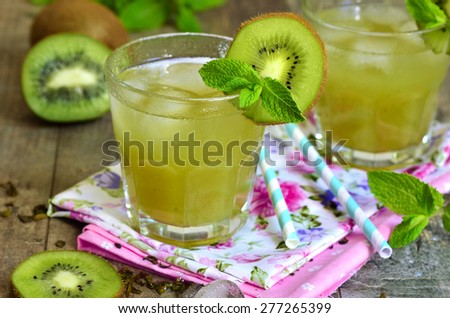 Iced green tea with kiwi and honey in a glass. - stock photo