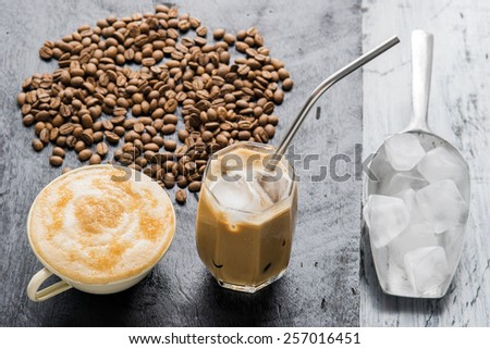 Iced latte coffee homemade making from ice cubes frozen served with milk  in a glass. - stock photo
