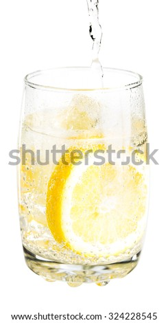 iced soda with lemon slice on white background