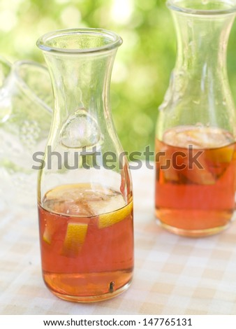 Iced tea in bottle with lemon. selective focus