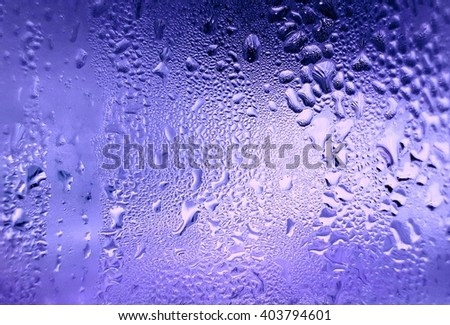 iced water drop on purple background - stock photo