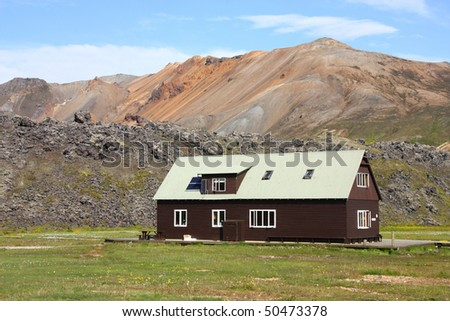 Iceland. Beautiful mountains and a wooden house. Famous volcanic area with rhyolite rocks - Landmannalaugar.