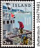 ICELAND - CIRCA 1963: A stamp printed in Iceland dedicated to global campaign against hunger shows fishermen, circa 1963 - stock photo