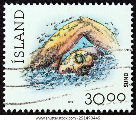 """ICELAND - CIRCA 1994: A stamp printed in Iceland from the """"Sports """" issue shows swimming, circa 1994.  - stock photo"""