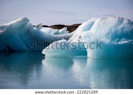 Iceland, Jokulsarlon Glacier Lagoon, blue icebergs and clear sky in a sunny day