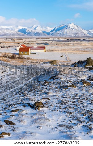 Iceland Landscape : House with Frozen Mountain behind - stock photo