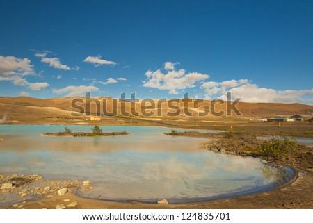 Iceland, Myvatn area - Small lake, colourful ground. Volcanic landscape. - stock photo