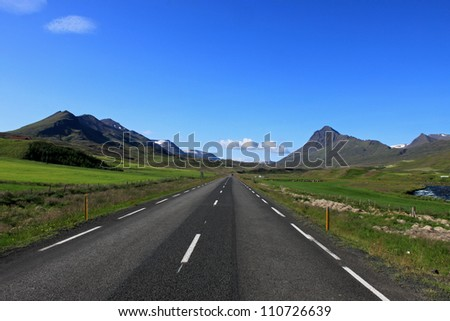 Iceland summer holiday: lonley road in crystal clear air