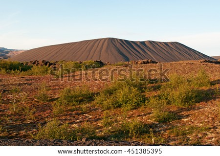 Iceland: view of volcano Hverfjall on August 22, 2012. Hverfjall is a tuff ring volcano on Myvatn lake, in northern Iceland: the crater is approximately 1 kilometer in diameter - stock photo