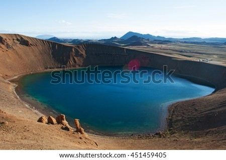 Iceland: Viti crater and lake on August 28, 2012. Viti is an explosion crater formed in 1734 by a massive eruption in the Krafla volcano, its diameter is 300 meters and it has a green lake inside it - stock photo