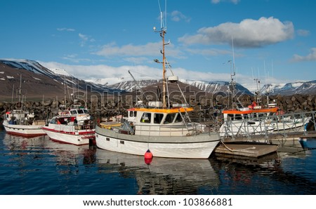 Icelandic Fishing Boats:  Commercial fishing boats gather in a small harbor on the western coast of Iceland. - stock photo