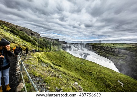 Icelandic hiking trail with tourists near the cascade river. 26 August, 2016. Iceland