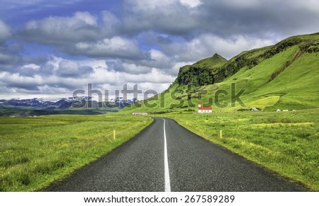 Icelandic mountain landscapes with asphalt road - stock photo