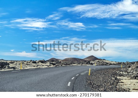 Icelandic road on a sunny day - stock photo