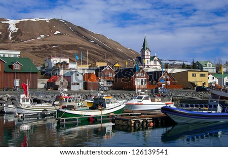 Icelandic Seaport: Boats for fishing and for whale watching tours gather at the port of Husavik, Iceland. - stock photo
