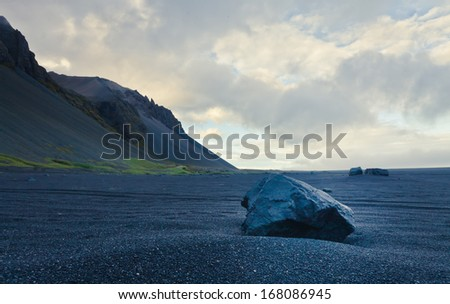 Icelandic Volcanic Beach Reynisfiyara on the coast of norwegian sea - stock photo