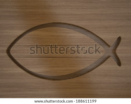 Ichthys. Christian symbol cut out on wood. - stock photo