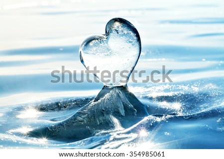 Icicle in the form of heart on the ice of Lake Baikal. From Siberia with love. Cold heart. Love of nature. Blue ice on the surface of Lake Baikal, Siberia, Russia. Horizon. Winter.  - stock photo
