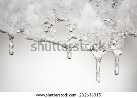 Icicles after snowfall - stock photo
