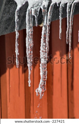 Icicles against red wall